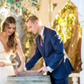 Bride and Groom nail shut box of wine during wedding ceremony
