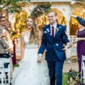 Bride and Groom celebrate and walk down aisle after first kiss