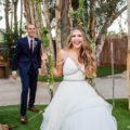 Groom pushes happy bride on wooden swing