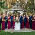 Group portrait of wedding couple with bridal party after outdoor wedding ceremony
