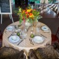 Bohemian-inspired sweetheart table at rustic wedding venue