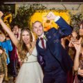 Wedding Couple cheer during grand bubble exit after wedding reception