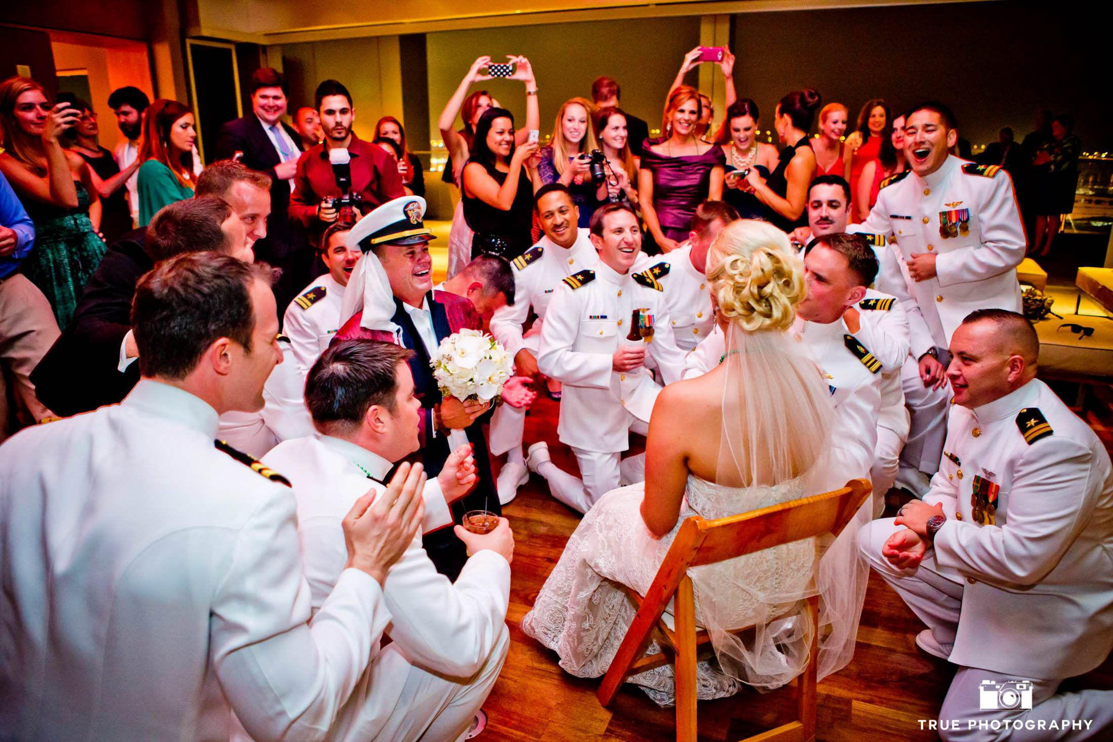 Groom entertains his bride during garter toss.