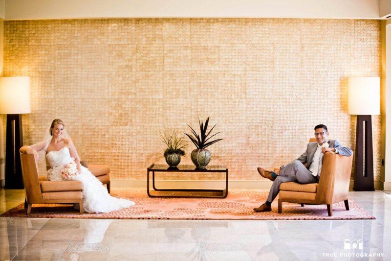 Newlyweds sit seperately