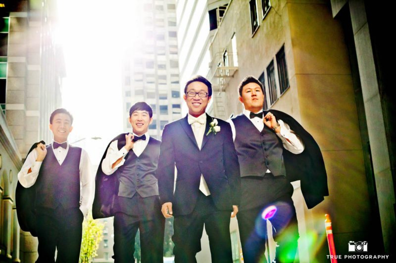 Groom and groomsmen wear black and white