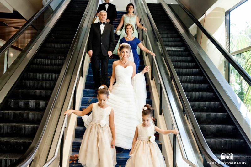 Bridal party on escalator