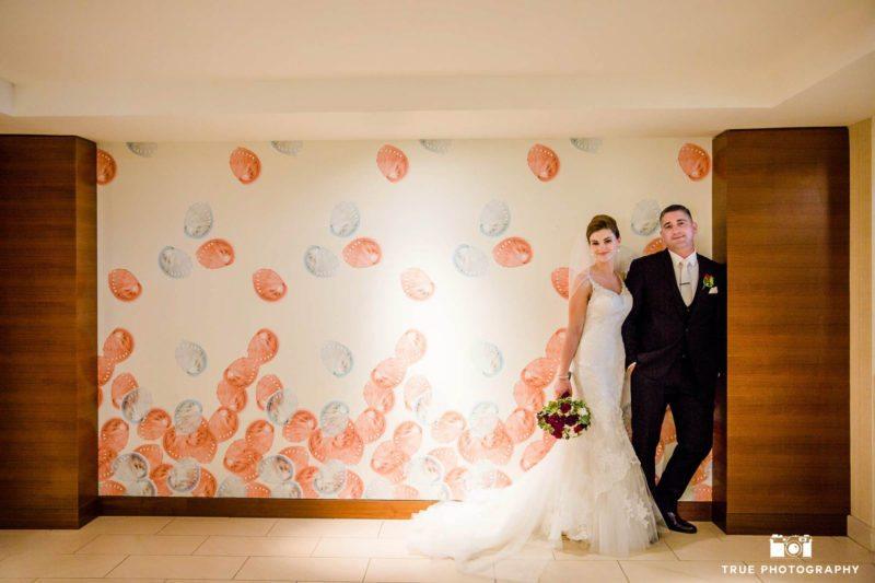 Bride in groom in front of modern art