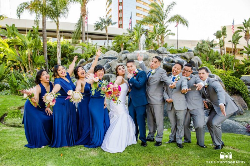 Newlyweds being silly with their bridal party
