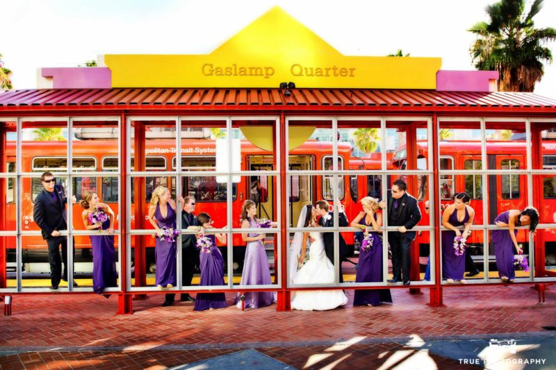 Bride and groom at trolley station with their bridal party