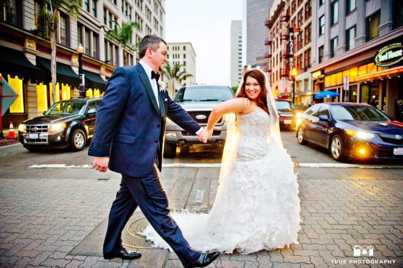Bride and Groom walk across city street in Downtown San Diego