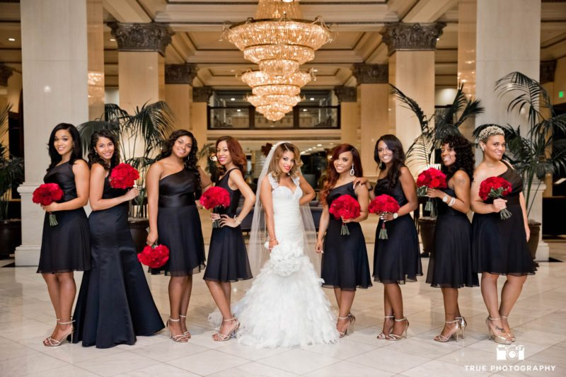 Bride poses for stylish portrait with bridesmaids at the US Grant