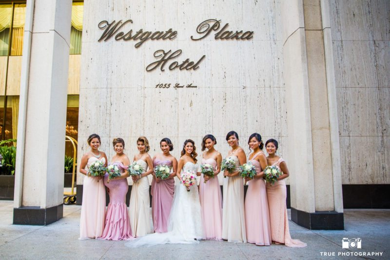 Formal portrait of bride with bridesmaids at Westgate Plaza Hotel
