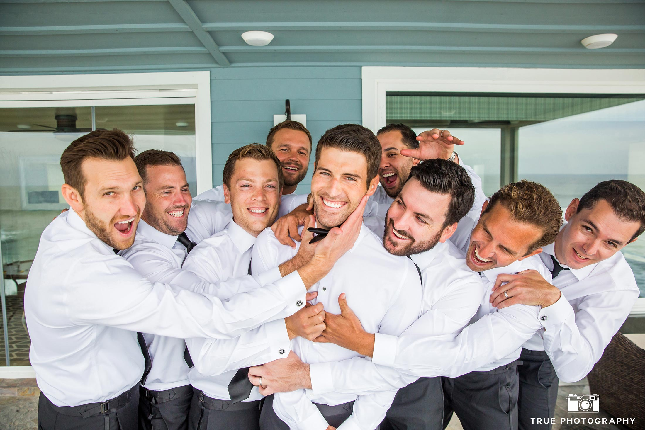 Groomsmen having fun at wedding San Diego